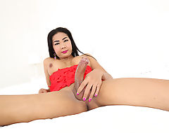 Asian shemale sultry Sa plays with a big buttplug in her ass