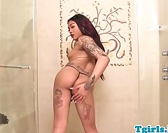 Ebony tgirl babe covered in ink wanking solo