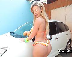 Tranny car washing and banging outdoors