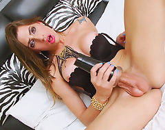 Big tits tranny Stefany fucks a fleshlight toy in bed