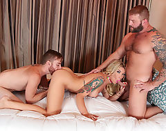 Tall Shemale Aubrey Kate takes two huge cocks