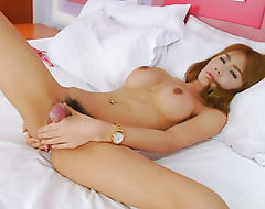 Sexy shemale masturbates her cock in bed