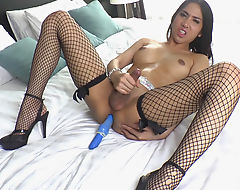 Asian Shemale Balloon Plays With A Dildo