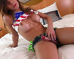 Enhanced tits tranny gets her tight ass ripped on the bed