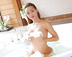 Big tits TS Sammy B teasing in the bathtub and masturbates