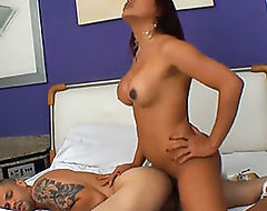 Shemale is toping her man bareback