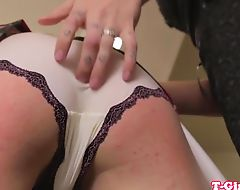 Kinky shemales stimulate penis with a rod