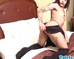 Tattooed ebony tgirl jerking her hard cock