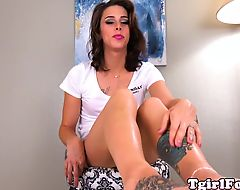 Tattooed shemale showing pedicured feet