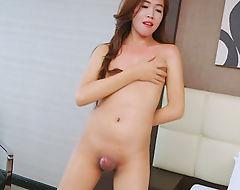 Tight ladyboy Sumkit shows off ass and masturbates cock