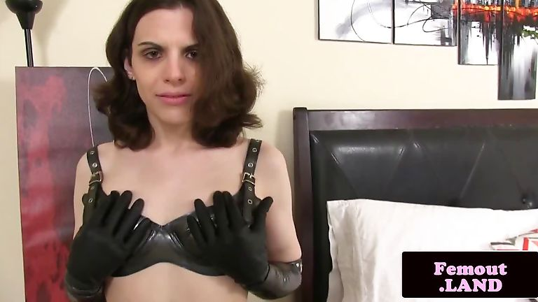Latex femboy toying her ass with big buttplug