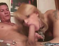 Blonde tranny sucks cock before fucking a studs ass