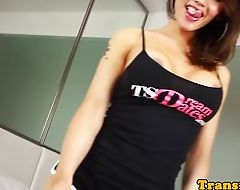 Busty ladyboy toys tight ass while tugging