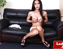 Classy ladyboy teases and tugs herself