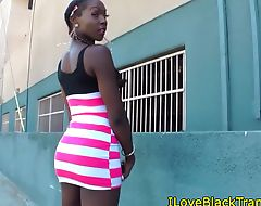Nubian transexual solo plays with her ass
