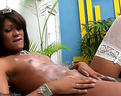 Ebony T-girl with sexy lips masturbates really big shecock