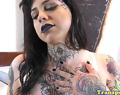 Tattooed transsexual wanks and cums hard