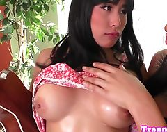Ebony tranny jerks off while dildoed in ass