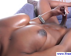Ebony shemale cums after tugging her nob