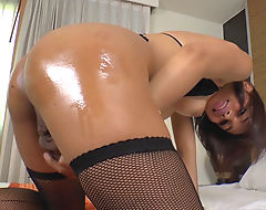 Thai ladyboy Jakki fucking her asshole with a purple dildo