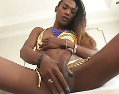 Dark skin ladyboy Jina anal pounded hard while sucking