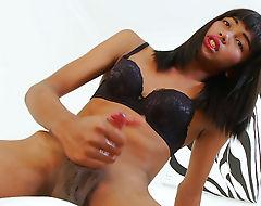 Skinny brunette shemale Modnoy masturbating her cock