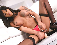 Black tranny fucking her ass with sextoy while masturbating