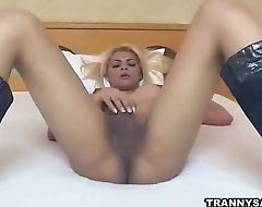 Busty blonde shemale jerks off before sucking cock