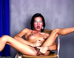 Hot ladyboy cam model is fingering her ass while jerking off