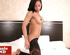 Stockinged tgirl tugging her hard ebony cock
