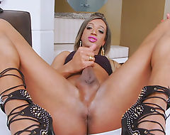 Big butt blonde shemale masturbates her shaft on the bed