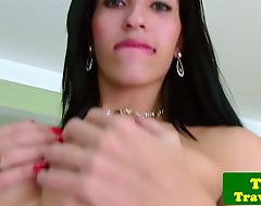 Latina tgirl jerking cock while in stockings