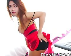 Adorable Asian shemale Yoghurt jerking off in her bedroom