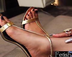 Gorgeous ts ebony Megan Snow is a horny foot fetishist