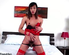 Beautiful Thai femboy in red lingerie reveals puffy nipples