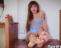 Footlover ladyboy teasing with red toenails