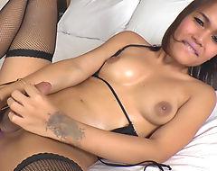 Thai ladyboy Jakki dildoing her asshole while masturbating