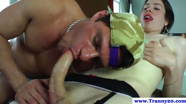 Tranny in white fishnets giving blowjob